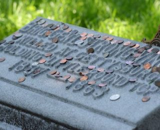 If You See A Coin Placed On Someone's Grave, Here's What It Means